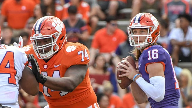Clemson offensive guard John Simpson (74) blocks for Clemson quarterback Trevor Lawrence (16) during the the spring game in Memorial Stadium in Clemson on Saturday, April 14, 2018.