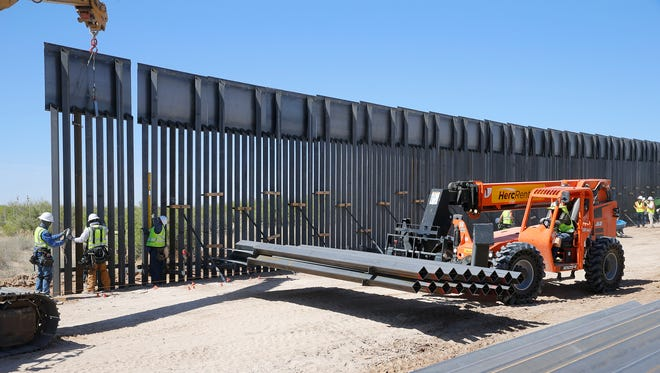 "A new $73 million bollard wall along a 20-mile portion of existing fence is going up along the U.S.-Mexico border in Santa Teresa, N.M. The construction of the ""president's border wall"" began April 9 and is moving swiftly. Construction of the wall, which will replace existing posts that serve as vehicle barriers in the area, is expected to be completed by March. The wall will stand 18 feet to 30 feet tall in different areas, depending on the terrain. ""It is going help maintain a secure border. It is going to establish the operational control that the president has mandated,"" El Paso Sector Chief Patrol Agent Aaron Hull said when construction was officially announced."