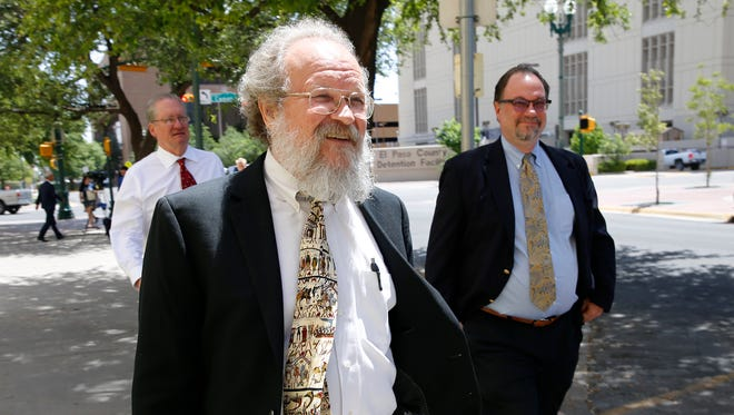 """Bankruptcy trustee Ronald Ingalls, center, Austin real estate broker Mark Hall, left, hired to possibly help sell William """"Billy"""" Abraham's buildings, and lawyer Stephen Sather leave the R.E. Thomason Federal Building and United States Courthouse for lunch Thursday afternoon."""