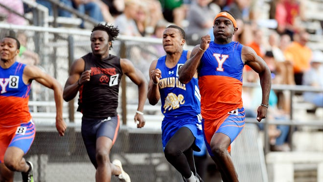 York High's Khalid Dorsey, right, wins the 100-meter dash in the 2018 YAIAA Track and Field Championships Friday, May 11, 2018, at Dallastown.