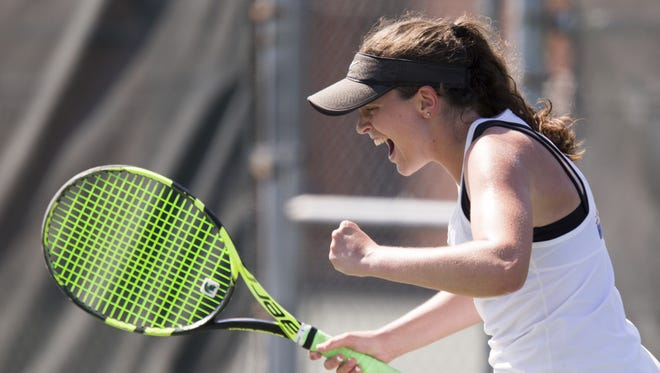 Lauren Lemonds of Carmel High School yells as she wins her number one singles victory in the IHSAA girls tennis team state finals, from North Central High School, Indianapolis, Saturday, June 2, 2018. The competition was won by Carmel High School.