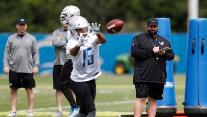 Lions head coach Matt Patricia watches and takes notes as receiver Golden Tate makes a catch during practice Tuesday.