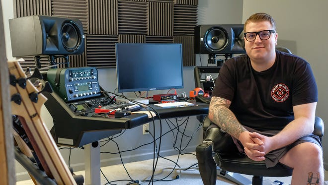 """Drummer in the metal band """"The Ghost Inside"""" Andrew Tkaczyk, has a studio and a place to practice his drums in his home in Holt.  Saturday, June 9, 2018."""