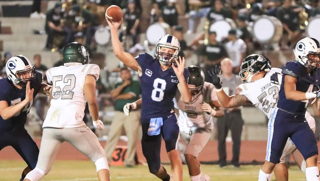 Central Valley Christian's QB Eric Dragt (C)  (8) passes under pressure from Dinuba during a Central Sequoia League game at CVC Football Stadium on Sept 28th, 2018.