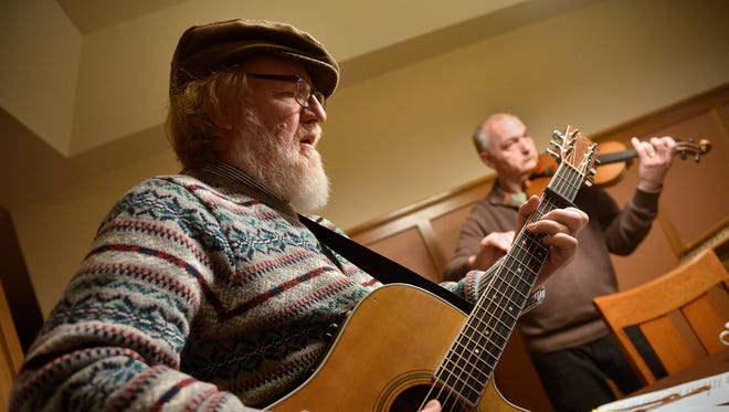 Charlie Roth, left, plays with Ring of Kerry during a practice at Paul Imholte's home March 2 in St. Cloud. Roth has released his seventh album.