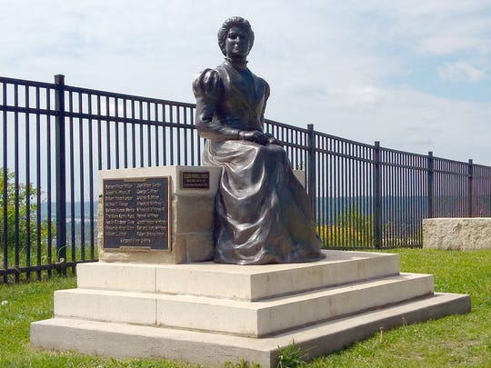 A sculpture of Ellen Hixon sits at the top of Granddad Bluff in La Crosse.