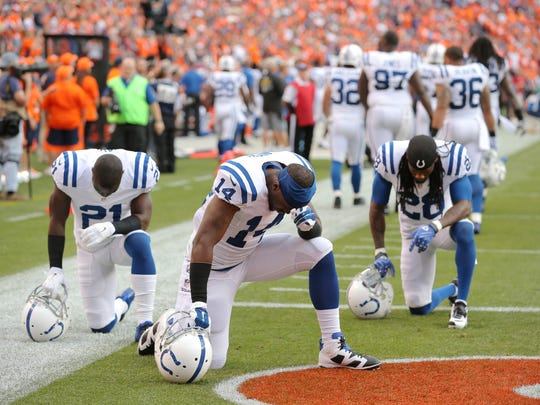 In 2014, Colts players Vontae Davis, left; Hakeem Nicks, center; and  Greg Toler prayed along the sideline before a game.