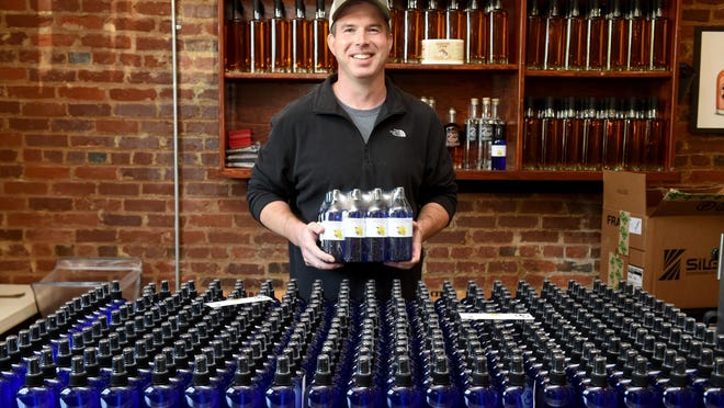 David Long, of 2nd City Distilling Company, holds some bottles of hand sanitizer made at 2nd City Distilling Company in Augusta, Ga. Long began producing hand sanitizer in response to a need in the community at the beginning of the pandemic.