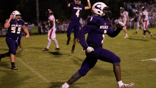 Joshua Watch storms the field after scoring Clarksville High's winning touchdown against Rossview on August 18, 2017.