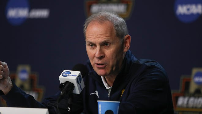 Michigan basketball coach John Beilein talks with reporters March 22, 2017.