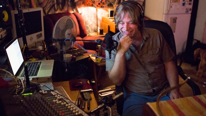 Nathan Moore laughs while interviewing The News Leader reporter Laura Peters about her #UpAllNight story during his online radio show, Revolution Radio, early in the morning on Friday, Aug. 22, 2014.
