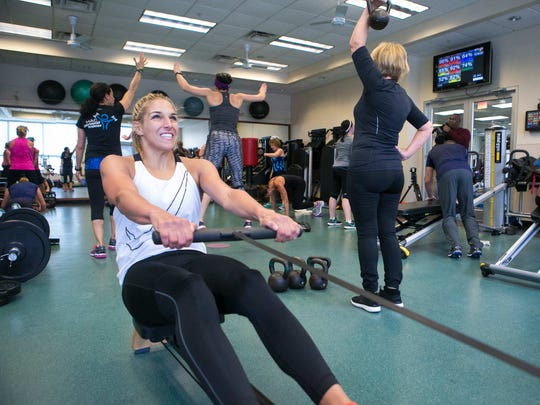Elena Delle Donne works a rowing machine station as she participates in a high-intensity small-group personal training class at Hockessin Athletic Club taught by personal trainer Dina Saitis.