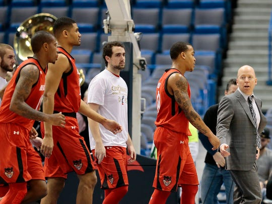 Cincinnati Bearcats head coach Mick Cronin shares words