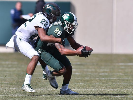 Michigan State's Josiah Scott (22), shown here in the spring game, likely will start at cornerback as a freshman.