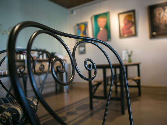 "Designer Kathleen Magner-Rios says she wanted to bring a flavor of Europe and ""old world feel"" to the Legal Grounds Cafe in Elsmere."