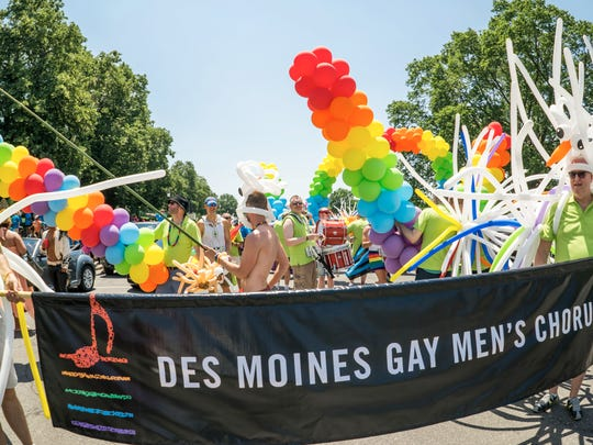 The Des Moines Gay Men Chorus prepares for the 2017 Pride Parade.