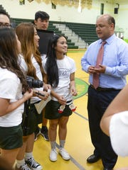 Guam Department of Education Superintendent Jon Fernandez, right, chats with Vivace choir members after the group's fundraiser performance at John F. Kennedy High School in Tamuning on Wednesday, Dec. 16.