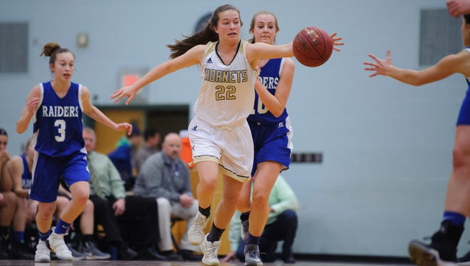 Essex's Emma Whitney (22) grabs the loose ball during the girls basketball game between the U-32 Raiders and the Essex Hornets at Essex High School on Wednesday night December 27, 2017 in Essex.