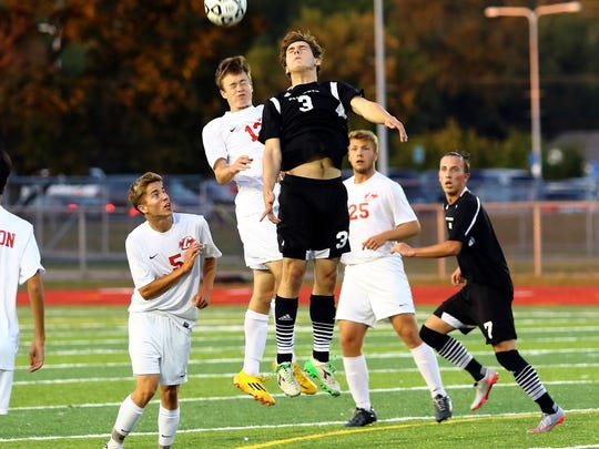 Plymouth and Canton players bump heads trying to gain possession Thursday night at P-CEP.