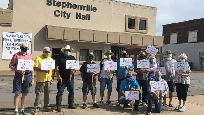 Several city retirees gathered in front of City Hall on Tuesday to petition the city council to reimburse the cost of living adjustment to their retiree benefits.
