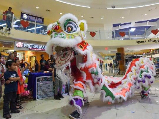 The Chinese School of Guam Lion Dance Team performs the traditional Chinese lion dance to celebrate the Chinese New Year at the Agana Shopping Center on Feb. 18, 2018.