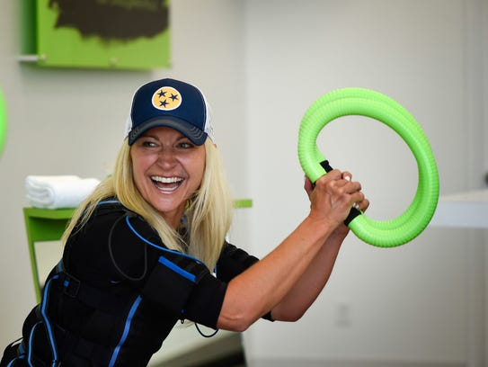 Mandy Oakes uses a new electric exercise workout at