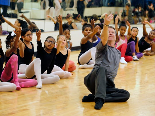 Gordon Havens, director of the Princesses Ballet, teaches choreography to dancers during practice at the Carl Lindner YMCA.