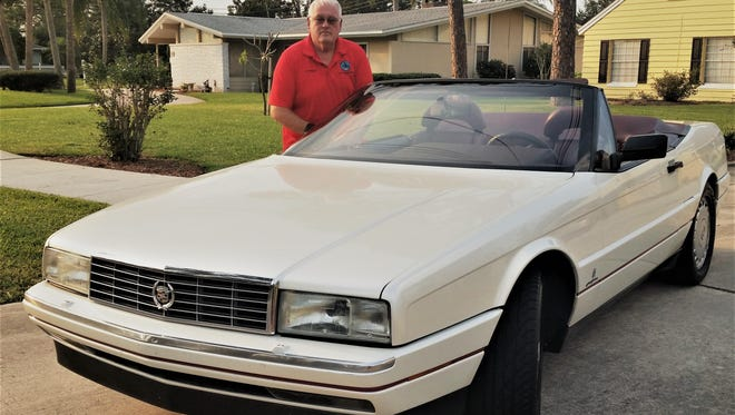 Joe Pinson shows off his posh 1992 Cadillac Allante.
