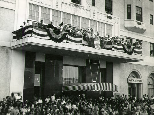 The San Carlos Hotel is pictured on Palafox Street during a parade in the 1960s.