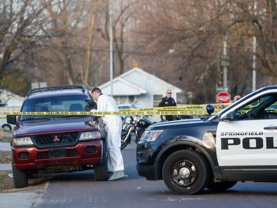 Springfield police investigate the scene of a homicide