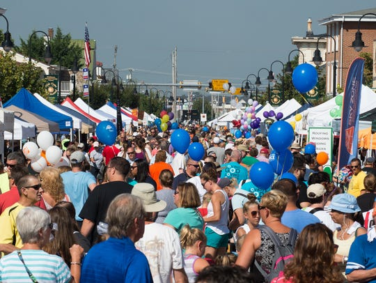 Festival goers pack Main Street at the Middletown Peach