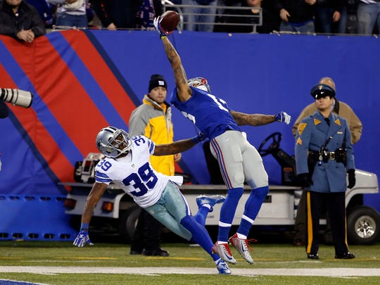 Nov 23, 2014; New York, NY, USA; New York Giants wide receiver Odell Beckham (13) makes a one handed catch for a touchdown in second quarter as he is defended by Dallas Cowboys cornerback Brandon Carr (39) at Metlife Stadium. Mandatory Credit: William Perlman/NJ Advance Media for NJ.com via USA TODAY Sports