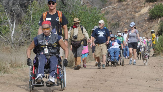 With Rich Buc behind him ready to help, Ricardo Melendez, a U.S Air Force veteran, makes his way through Sycamore Canyon during in the November 2017 Wheel to the Sea event. The event will be held again on May 5.
