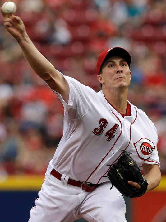 Cincinnati Reds starting pitcher Homer Bailey throws against the Cleveland Indians in the first inning of a baseball game, Thursday, Aug. 7, 2014, in Cincinnati. (AP Photo/Al Behrman)