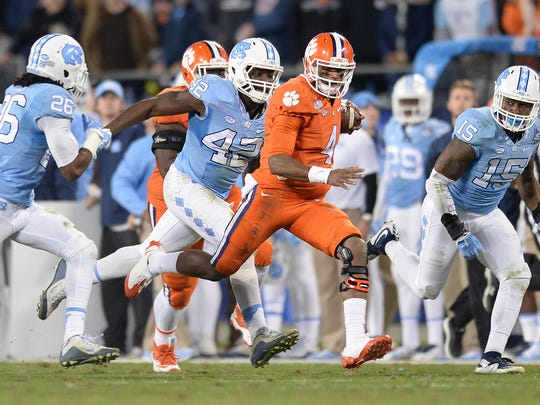 Clemson quarterback Deshaun Watson (4) carries for a big gain against North Carolina during the 2nd quarter of the ACC Championship at Bank of America Stadium in Charlotte Friday, Dec. 4, 2015.