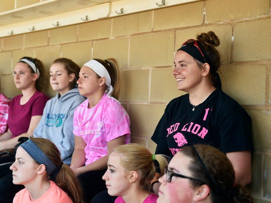 Red Lion's Hayley Taylor, top right, sits with the
