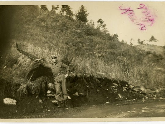 """Brock's girlfriend, Laura Mae Phillips, whom he later married, has written across this image of Brock """"My Man."""" This photo may have been taken near a silver mine in South Korea. When the North Koreans invaded, they tried to extract as much of the resources as possible from South Korea."""