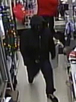 Police are looking for this man in connection with the robbery of a Lansing Family Dollar store Tuesday night.