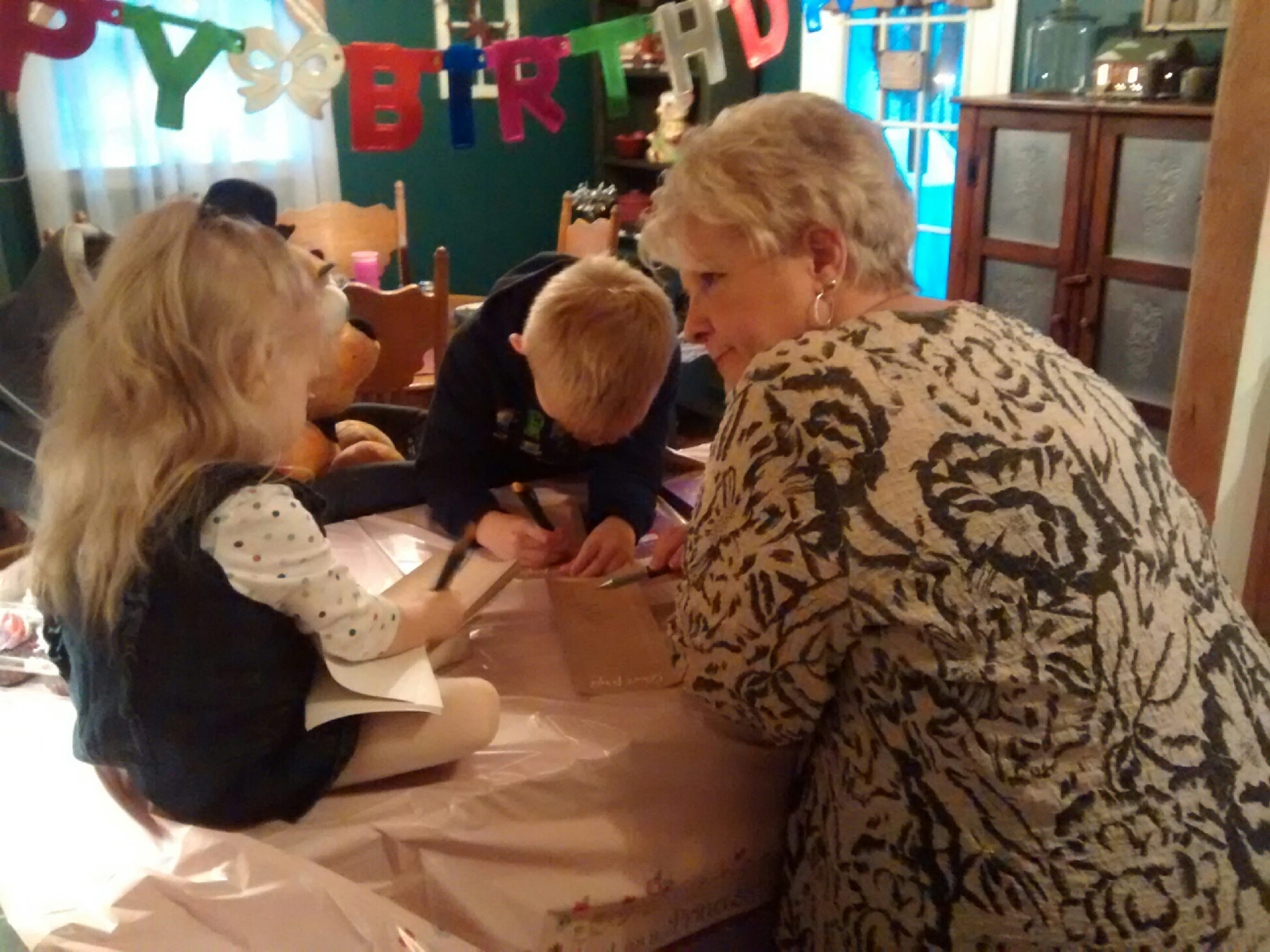 Cathy Sterrett spends time with her grandchildren at a birthday party.