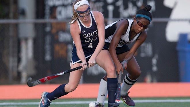 Middletown North's Kaylah Igarta tries to stop Middletown South's Meredith McNamara during first half action. Middletown South  Girls Field Hockey defeats Middletown North 5-3 in Shore Conference Tournament game.