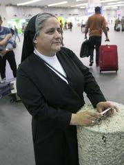 Sister Olga Estrada waits for another nun arriving