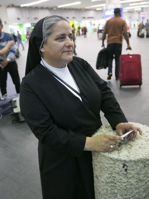 Sister Olga Estrada waits for another nun arriving from Colombia at the Benito Juarez International Airport in Mexico City, Feb. 11, 2016.