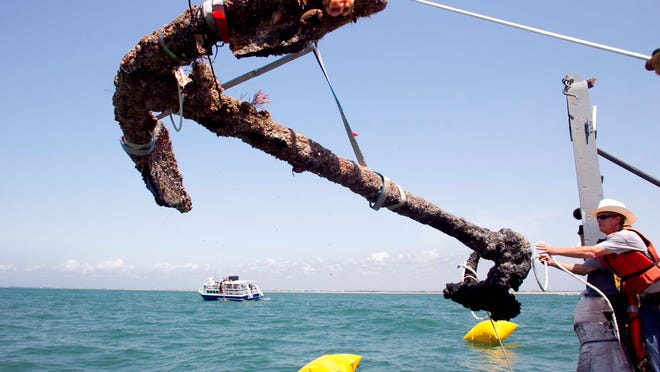 A 3,000 pound anchor from what is believed to be the wreck of the pirate Blackbeard's flagship, the Queen Anne's Revenge, is recovered from the ocean where it had been since 1718, in 2011.
