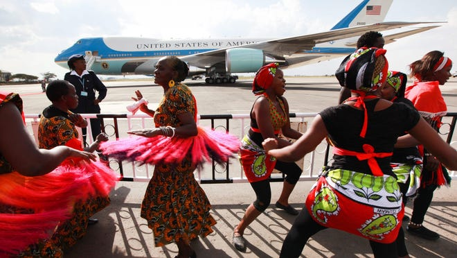 04861740.jpg epa04861740 Kenyan traditional dancers singing as they wait to entertain US President Barrack Obama (not pictured) upon his arrival to board Airforce One (back) for his departure to Ethiopia, at the Jomo Kenyatta International Airport (JKIA) in Nairobi, Kenya, 26 July 2015. His departure comes after his three-day visit to Kenya. It was his first visit to his father's homeland since becoming president. He promoted Africa as a hub for global economic growth and addressed issues on terrorism, economic recovery and human rights. EPA/DANIEL IRUNGU