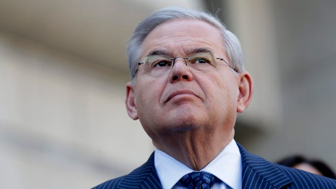 epa04690302 New Jersey Senator Robert Menendez speaks with media after his arraignment on federal corruption charges at Federal Court in Newark, New Jersey USA, 02 April 2015. Dr. Salomon E. Melgen along with Senator Robert Menendez were indicted on federal charges of corruption.  EPA/ANDREW GOMBERT ORG XMIT: agx11