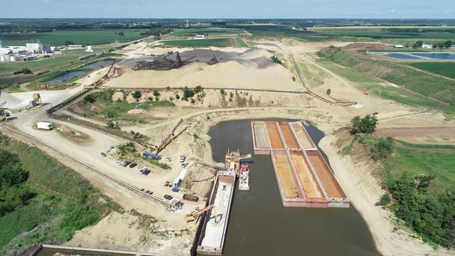 This drone photo shows the Port of Henry being developed on the west side of the Illinois River just north of Henry through the gravel mining operation of Ozinga Materials Inc. The Marshall County Board has asked the city of Henry to place conditions on a proposed solid waste transfer station at the city's port. The conditions would restrict the source and type of waste that would be handled at the facility.