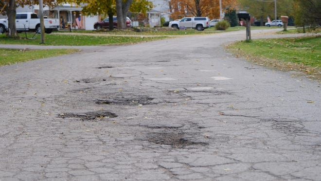 Potholes are seen in Coach-Lite Drive in Raisin Township. The township board agreed on Feb. 8 that $300,000 should be transferred from the general fund to continue road repairs in 2021 despite millage proposal failing in the 2020 election.