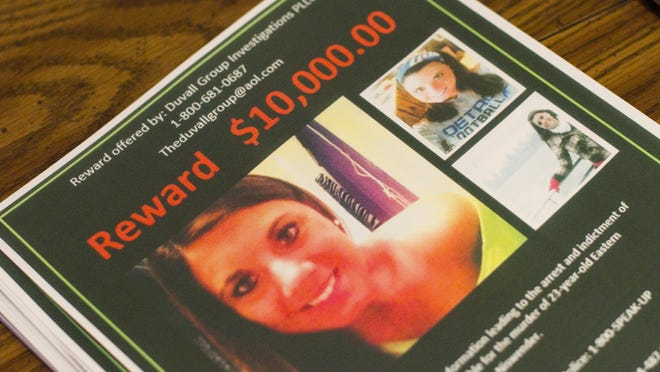 Reward flyers for information about Julia Niswender's death sit on the kitchen table at her mother's home in Monroe on April 9, 2013. Her stepfather was arrested last month.