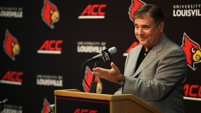 U of L athletic director Tom Jurich talks with media during the Cardinals' introductory ACC press conference last July.