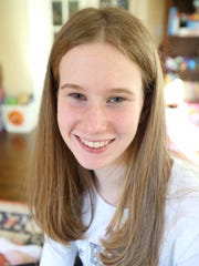 Olivia Curran who is a cross-country runner for Hackley was photographed in her home in White Plains Nov. 10, 2017.